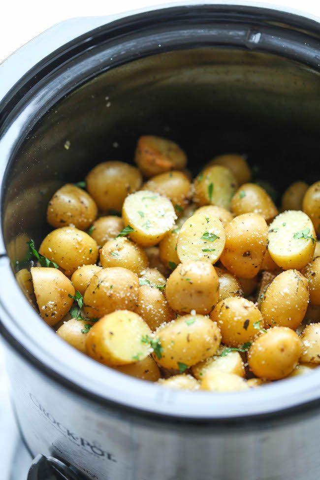 "<p>There's nothing better than a side dish that can be tossed in the slow cooker while you're busy preparing the rest of a large meal.</p><p><strong>Get the recipe at <a href=""http://damndelicious.net/2014/12/23/slow-cooker-garlic-parmesan-potatoes/"" rel=""nofollow noopener"" target=""_blank"" data-ylk=""slk:Damn Delicious"" class=""link rapid-noclick-resp"">Damn Delicious</a>.</strong> </p>"
