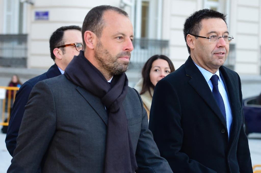 FC Barcelona's former president Sandro Rosell (L), pictured in February 2016, acted as a consultant for Qatar's bid to host the 2022 World Cup, and FIFA allegedly sent $2 million to the bank account of Rosell's 10-year-old daughter (AFP Photo/JAVIER SORIANO)