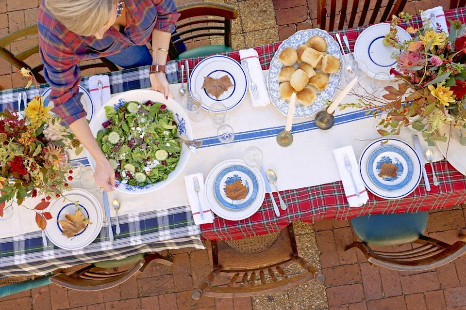 """<p>If you're not visiting relations this year, it doesn't mean Thanksgiving has to be a solo affair. Host a laid-back feast with your community. This BYOCACD (""""Bring Your Own Chair and Covered Dish"""") party, courtesy of <a href=""""https://www.countryliving.com/entertaining/a45231/thanksgiving-laurel-mississippi-erin-ben-napier/"""" rel=""""nofollow noopener"""" target=""""_blank"""" data-ylk=""""slk:HGTV Home Town's Erin and Ben Napier"""" class=""""link rapid-noclick-resp"""">HGTV <em>Home Town's </em>Erin and Ben Napier</a> features plenty of delicious sides that everyone can share. Assign recipes out to each friend—or go generous, and make it all yourself! </p><p><strong>Main Course:</strong></p><p><a href=""""https://www.countryliving.com/food-drinks/recipes/a45298/red-chile-and-orange-glazed-turkey-recipe/"""" rel=""""nofollow noopener"""" target=""""_blank"""" data-ylk=""""slk:Red Chile and Orange-Glazed Turkey"""" class=""""link rapid-noclick-resp"""">Red Chile and Orange-Glazed Turkey</a></p><p><strong>Sides:</strong></p><p><a href=""""https://www.countryliving.com/food-drinks/recipes/a45284/erin-napier-skillet-cornbread-recipe/"""" rel=""""nofollow noopener"""" target=""""_blank"""" data-ylk=""""slk:Erin Napier's Skillet Cornbread"""" class=""""link rapid-noclick-resp"""">Erin Napier's Skillet Cornbread</a></p><p><a href=""""https://www.countryliving.com/food-drinks/recipes/a45296/grape-salad-recipe/"""" rel=""""nofollow noopener"""" target=""""_blank"""" data-ylk=""""slk:Grape Salad"""" class=""""link rapid-noclick-resp"""">Grape Salad</a><br></p><p><span class=""""redactor-invisible-space""""><a href=""""https://www.countryliving.com/food-drinks/recipes/a45272/cheesy-rice-recipe/"""" rel=""""nofollow noopener"""" target=""""_blank"""" data-ylk=""""slk:Cheesy Rice"""" class=""""link rapid-noclick-resp"""">Cheesy Rice</a><br></span></p><p><span class=""""redactor-invisible-space""""><span class=""""redactor-invisible-space""""><a href=""""https://www.countryliving.com/food-drinks/recipes/a45288/roasted-brussels-sprouts-recipe/"""" rel=""""nofollow noopener"""" target=""""_blank"""" data-ylk=""""slk:Roasted Brussels Sprouts"""" class=""""link rapid-"""