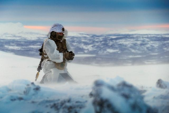 A Royal Marines assault engineer of 45 Commando preparing a charge during ice demolition training in the Arctic Circle, taken by Leading Photographer Stevie Burke