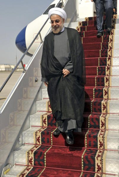 In this photo released by the official website of the office of the Iranian Presidency, Iran's President Hasan Rouhani steps out of his plane upon arrival to attend the Shanghai Cooperation Organization at Bishkek, Kyrgyzstan, Thursday, Sept. 12, 2013. The U.N. has slotted the new moderate-leaning president to address the global gathering of leaders on Sept. 24 - just hours after U.S. President Barack Obama is scheduled to wrap up his speech. (AP Photo/Presidency Office, Hojjat Sepahvand)