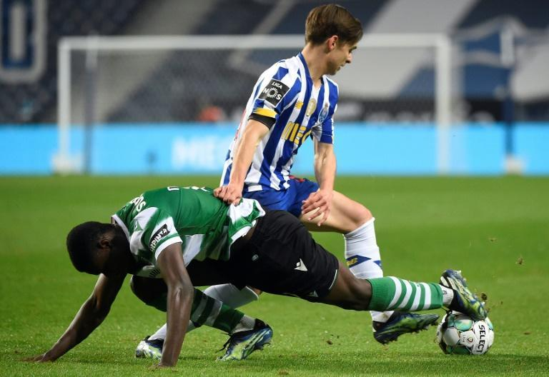 Sporting Lisbon's 0-0 draw at Porto keeps them on course for a first Portuguese title in nearly 20 years