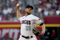 Arizona Diamondbacks pitcher Merrill Kelly throws against the Los Angeles Angels in the first inning during a baseball game, Friday, June 11, 2021, in Phoenix. (AP Photo/Rick Scuteri)
