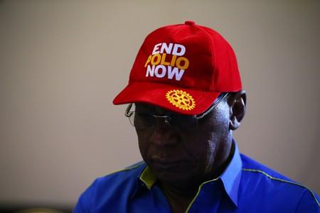 Chairman Nigeria National PolioPlus Committee of Rotary International, Dr. Tunji Funsho wears a cap during a news conference marking the 3-year-polio-free milestone in Abuja