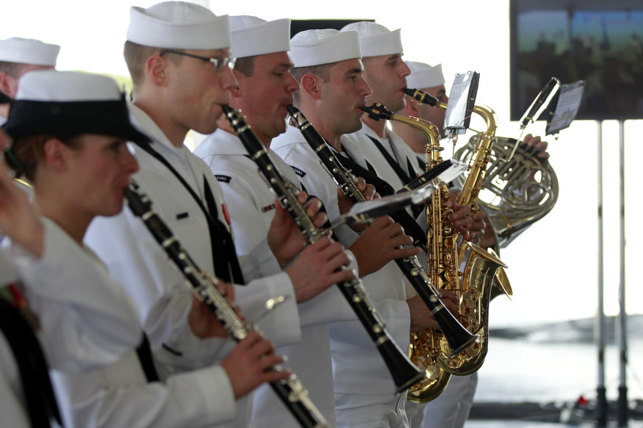 The Navy Band of New Orleans plays the National Anthem during christening ceremonies for the USS Somerset at the Huntington Ingalls Industries Shipyard in Avondale, La., Saturday, July 28, 2012. It was the last of three Navy ships named for 9/11 attack sites, christened Saturday in honor of the passengers and crew of the plane that crashed short of the terrorists' intended target after passengers stormed the cockpit.(AP Photo/Gerald Herbert)