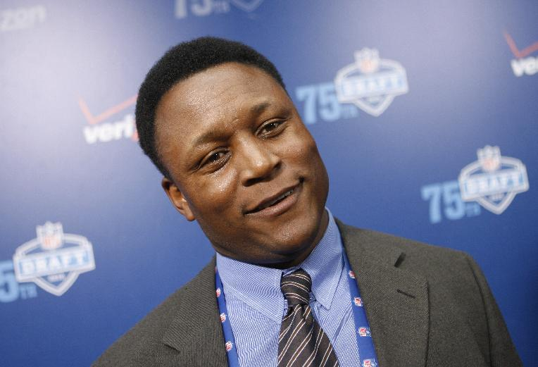 FILE - This April 22, 2010 file photo shows former NFL running back Barry Sanders arriving for the NFL Draft in New York. A Houston couple desperate for a baby was trying to raise money for a last attempt at in vitro fertilization. To do so, they're auctioing a rare Barry Sanders football card. Now, the Hall of Fame running back is spreading the word about the sale in hopes of raising the $20,000 the couple needs. (AP Photo/Jason DeCrow, File)