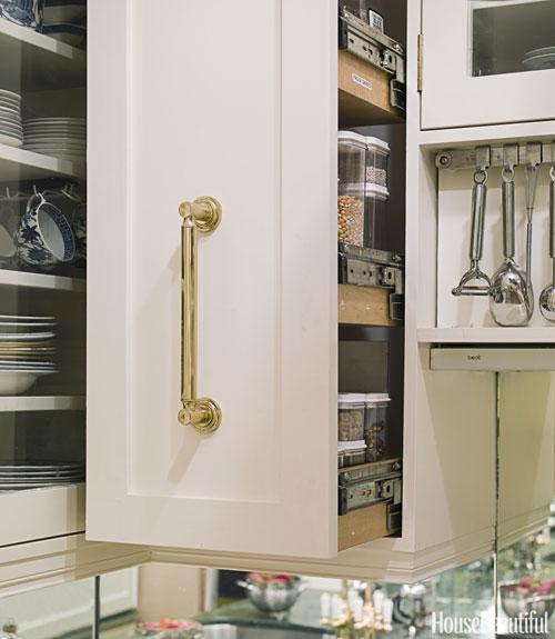 "<div class=""caption-credit"">Photo by: Eric Piasecki</div><div class=""caption-title"">Avoid Searching for Ingredients With a Pull-Out Pantry</div><p>  In designer Stephanie Stokes's 48-square-foot New York City kitchen, the ""pantry"" for dry goods consists of two cabinets that slide out over the countertop so that everything is easy to find. </p> <p>  <b>See more:</b>  <br>  <a rel=""nofollow"" href=""http://www.housebeautiful.com/decorating/home-makeovers/101-makeover-ideas-0209?link=emb&dom=yah_life&src=syn&con=blog_housebeautiful&mag=hbu"" target=""""><b>101 Easy Home Makeover Ideas</b></a>  <br>  <a rel=""nofollow"" href=""http://www.housebeautiful.com/kitchens/tips/unique-kitchen-details?link=emb&dom=yah_life&src=syn&con=blog_housebeautiful&mag=hbu"" target=""""><b>Unique Kitchen Details That Wow</b></a> </p>"