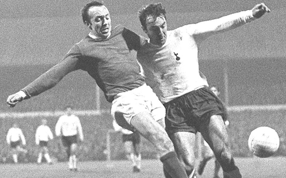 Manchester United's Nobby Stiles (left) and Tottenham Hotspur's Jimmy Greaves in a tussle for the ball during the First Division match at White Hart Lane - PA Archive