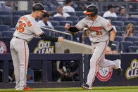 Baltimore Orioles' Austin Hays (21) celebrates his solo home run with third base coach Tony Mansolino (36) during the third inning of the team's baseball game against the New York Yankees, Monday, Aug. 2, 2021, in New York. (AP Photo/Mary Altaffer)