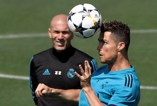 Cristiano Ronaldo and Zinedine Zidane attend a training session during Real Madrid's Media Open Day ahead of their UEFA Champions league final