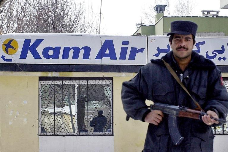 An Afghan soldier guards the Kam Air office in Kabul, on February 4, 2005