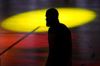 FILE - In this Oct. 11, 2020, file photo, Los Angeles Lakers' LeBron James (23) is seen silhouetted during introductions prior to Game 6 of basketball's NBA Finals against the Miami Heat in Lake Buena Vista, Fla. James was announced Saturday, Dec. 26, as the winner of The Associated Press' Male Athlete of the Year award for a record-tying fourth time. (AP Photo/Mark J. Terrill, File)