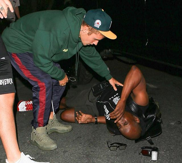 Justin Bieber checking on Maurice Lamont after the accident. (Photo: GAMR/Backgrid)