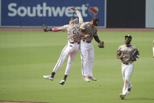 San Diego Padres' Fernando Tatis Jr., and Trent Grisham celebrate after beating the San Francisco Giants in a baseball game Sunday, Sept. 13, 2020, in San Diego. (AP Photo/Derrick Tuskan)