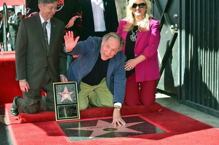 George Segal places his hand on his Hollywood Walk of Fame star in February 2017