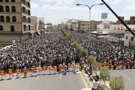 Followers of Shi'ite Houthi group pray during rally to denounce fuel price hikes and to demand for resignation of government in Sanaa