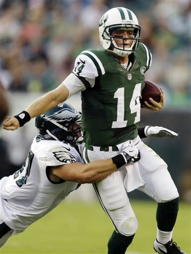 New York Jets quarterback Greg McElroy (14) is tackled by Philadelphia Eagles linebacker Ryan Rau in the first half of a preseason NFL football game, Thursday, Aug. 30, 2012, in Philadelphia. (AP Photo/Matt Rourke)