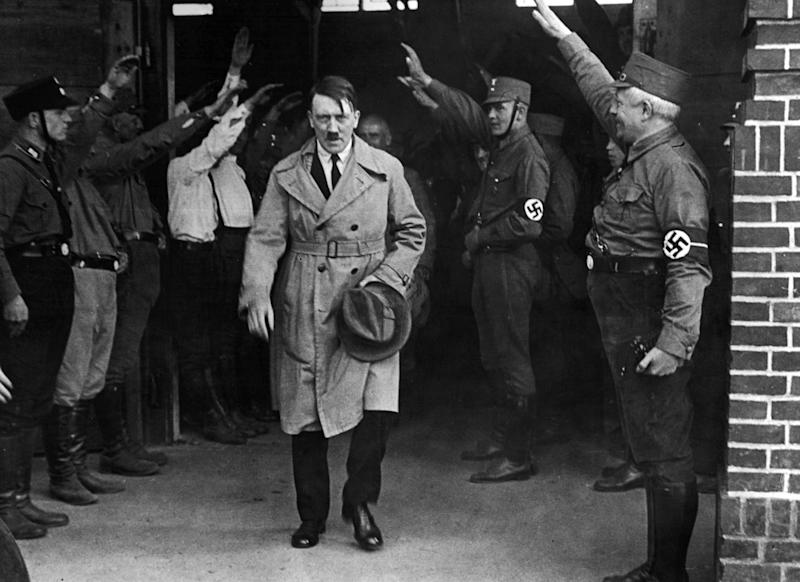 "FILE - In this Dec. 5, 1931 file photo, Adolf Hitler, leader of the National Socialists, is saluted as he leaves the party's Munich headquarters. The book, ""Human Rights After Hitler"" by British academic Dan Plesch, says Hitler was put on the United Nations War Crimes Commission's first list of war criminals in December 1944, but only after extensive debate and formal charges brought by Czechoslovakia. Plesch, who led the campaign for open access to the commission's archive, told The Associated Press on Tuesday, April 18, 2017, that the documents show ""the allies were prepared to indict Hitler as head of state, and this overturns a large part of what we thought we knew about him."" (AP Photo, File)"