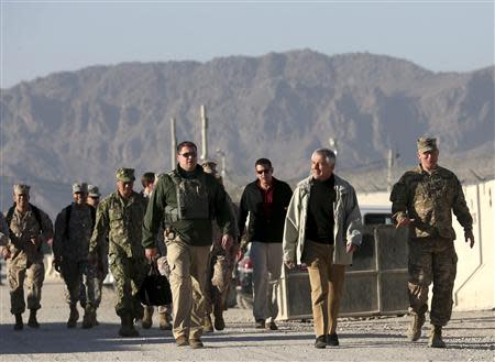 U.S. Defense Secretary Chuck Hagel (2nd R) walks to speak to U.S. troops at the Kandahar air base in Kandahar, Afghanistan December 8, 2013. REUTERS/Mark Wilson/Pool