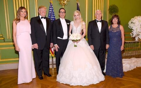 First Lady Melania Trump, President Donald Trump, Vice President Mike Pence, and Second Lady Karen Pence pose at the wedding of Secretary of the Treasury Steven Mnuchin and Louise Linton in June this year - Credit: Getty