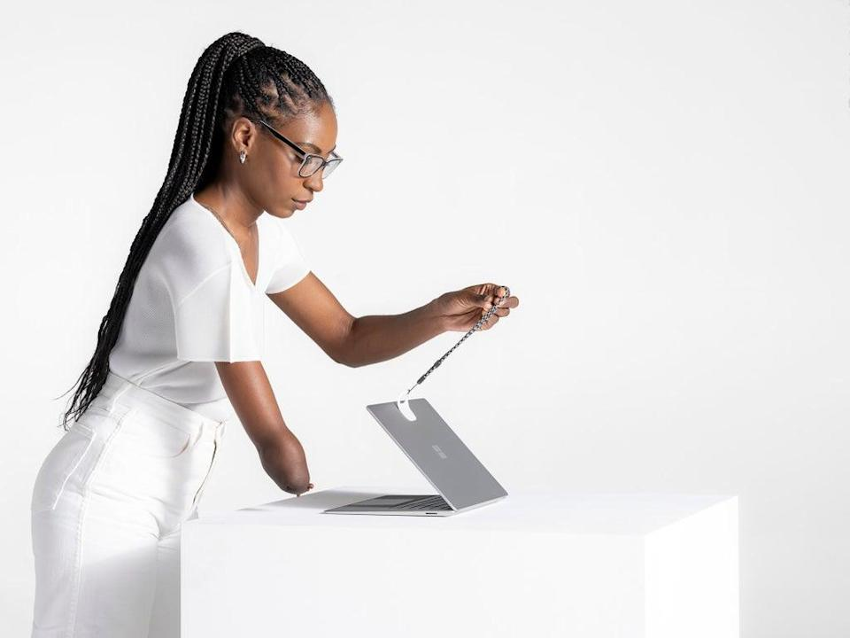 Microsoft's Surface Adaptive kit being used to help open a laptop (Microsoft/PA)