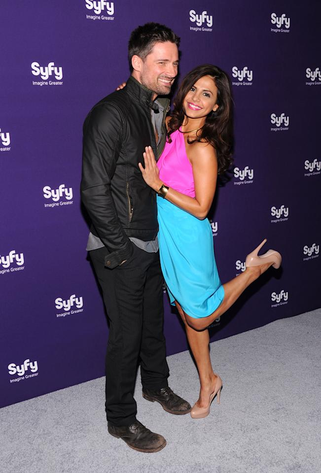 "Warren Christie and Azita Ghanizada (""<a href=""http://tv.yahoo.com/alphas/show/41988/"">Alphas</a>"") attend Syfy's 2012 Upfront event at the American Museum of Natural History on April 24, 2012 in New York City."