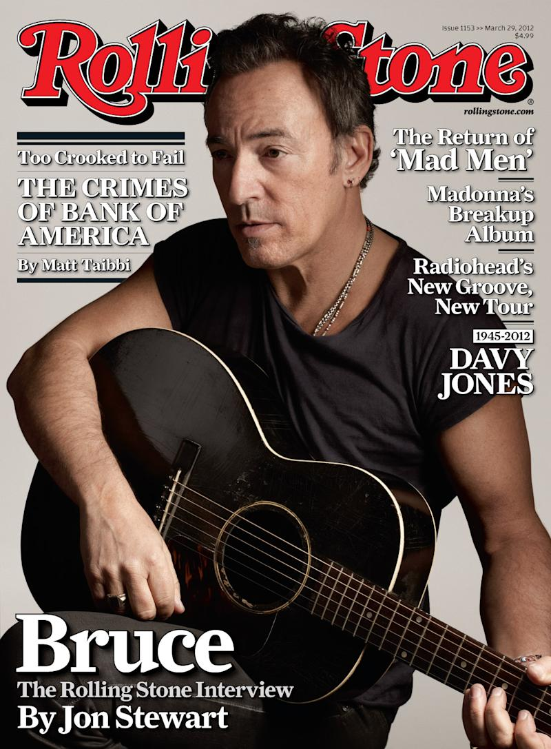 """In this magazine cover released by Rolling Stone, Bruce Springsteen is shown on the cover of the March 29, 2012 issue of """"Rolling Stone"""" magazine. Springsteen tells Rolling Stone in an interview by Jon Stewart that he shed tears when he heard Clarence Clemons' saxophone on """"Wrecking Ball.""""  After Clemons died, producer Ron Aniello took a live rendition of the concert staple """"Land of Hopes and Dreams,"""" separated Clemons' part and inserted it into a studio version of the song. (AP Photo/Rolling Stone)"""