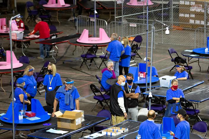 Contractors working for Cyber Ninjas examine ballots from the 2020 general election in Phoenix, May 3, 2021. (Photo by Courtney Pedroza for the Washington Post)