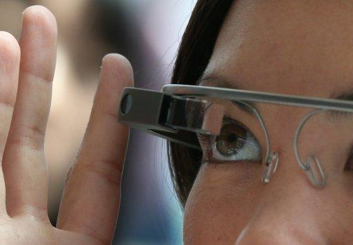 A woman tries on Google Glass during the Google I/O developer conference in San Francisco on May 17, 2013