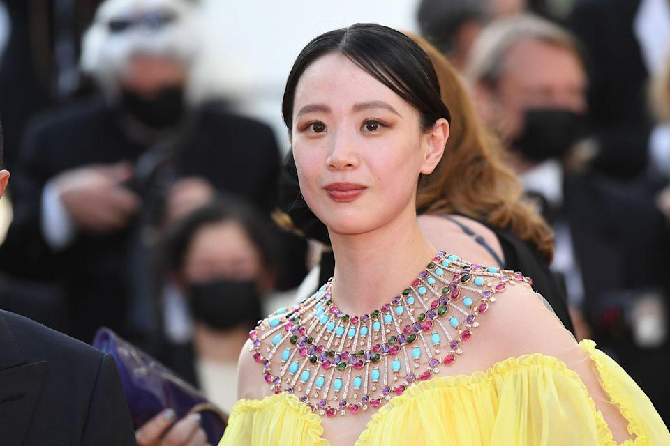 <p>The actress paired her lemon-coloured gown with a spectacular high jewellery poncho necklace from Bulgari's 'Cinemagia' collection. </p><p>Inspired by the house's close relationship with Elizabeth Taylor, particularly when she visited Rome to film Cleopatra, the elaborate bib is constructed in gold and set with colourful gemstone cabochons. </p>