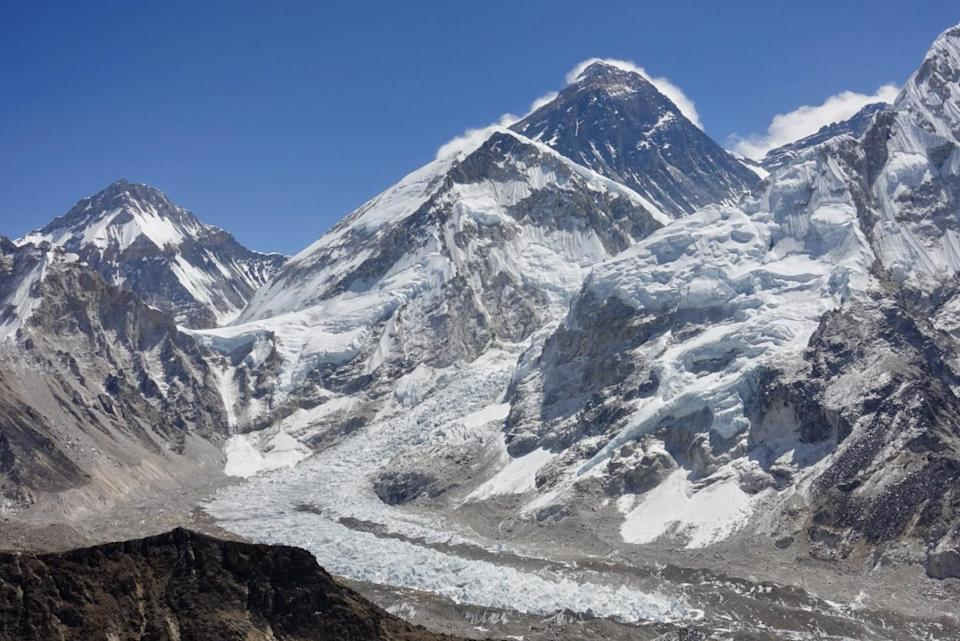 Snow and ice on the approach to Mt. Everest, with clouds forming off its peaks