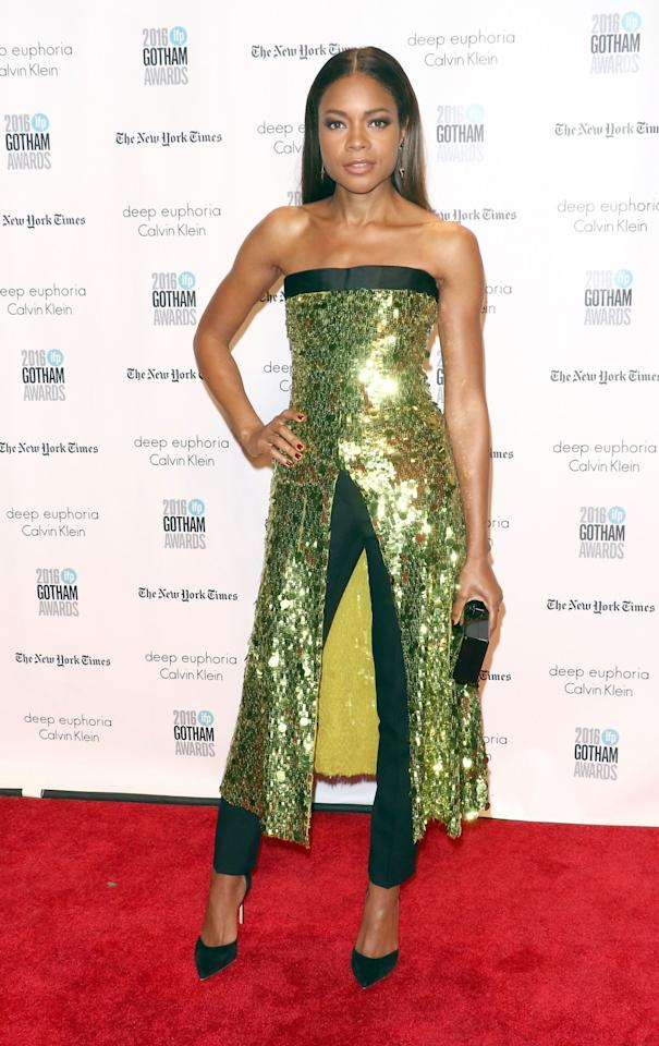 <p>Harris wore a unique citrine-and-black dress-and-pants combination with sequin detailing. The 40-year-old English actress completed the look with black pumps and a slicked-back middle-part hairstyle. (Photo: Getty Images) </p>