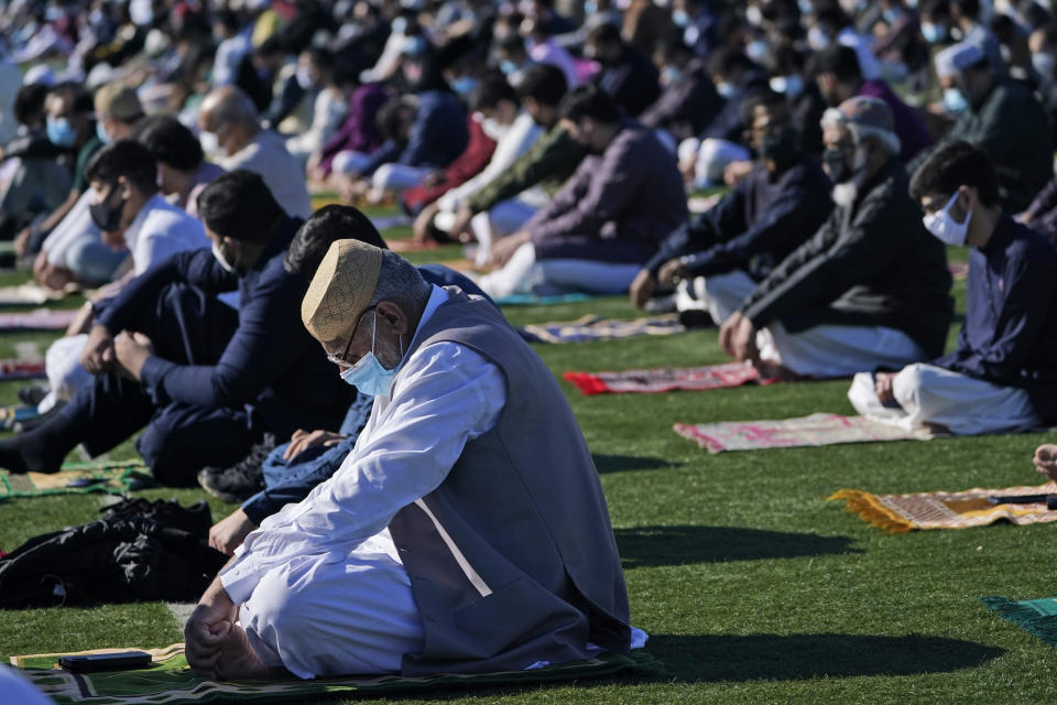 People participate in Eid al-Fitr prayers in Overpeck County Park in Ridgefield Park, N.J., Thursday, May 13, 2021. Millions of Muslims across the world are marking a muted and gloomy holiday of Eid al-Fitr, the end of the fasting month of Ramadan - a usually joyous three-day celebration that has been significantly toned down as coronavirus cases soar. (AP Photo/Seth Wenig)