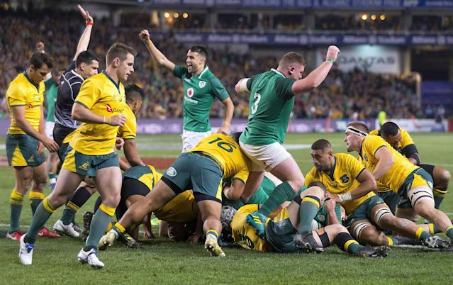Rugby Union - June Internationals - Australia vs Ireland - Sydney Football Stadium, Sydney, Australia - June 23, 2018 - CJ Stander of Ireland scores a try as teammates celebrate. AAP/Craig Golding/via REUTERS ATTENTION EDITORS - THIS IMAGE WAS PROVIDED BY A THIRD PARTY. NO RESALES. NO ARCHIVE. AUSTRALIA OUT. NEW ZEALAND OUT.