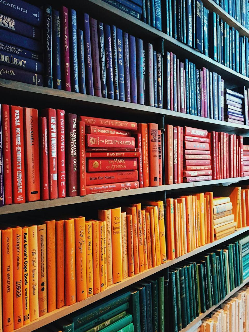"""<p>For some, their personal library is tucked away in a <a href=""""https://www.amazon.com/All-new-Kindle-Paperwhite-Waterproof-Storage/dp/B07CXG6C9W/?tag=syn-yahoo-20&ascsubtag=%5Bartid%7C10063.g.36459111%5Bsrc%7Cyahoo-us"""" rel=""""nofollow noopener"""" target=""""_blank"""" data-ylk=""""slk:Kindle"""" class=""""link rapid-noclick-resp"""">Kindle</a>. For others, it's scattered on shelves, nightstands, and floors throughout their home. Make your bookcases functional and pleasing to the eye by ordering books by height or color for a less cluttered, more cohesive look per organizing expert <a href=""""http://www.jeffreyphillip.com/"""" rel=""""nofollow noopener"""" target=""""_blank"""" data-ylk=""""slk:Jeffrey Phillip's"""" class=""""link rapid-noclick-resp"""">Jeffrey Phillip's </a>recommendation. </p>"""