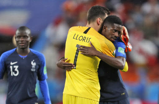 France goalkeeper Hugo Lloris, center and France's Samuel Umtiti celebrate at the end of the group C match between France and Peru at the 2018 soccer World Cup in the Yekaterinburg Arena in Yekaterinburg, Russia, Thursday, June 21, 2018. (AP Photo/Natacha Pisarenko)