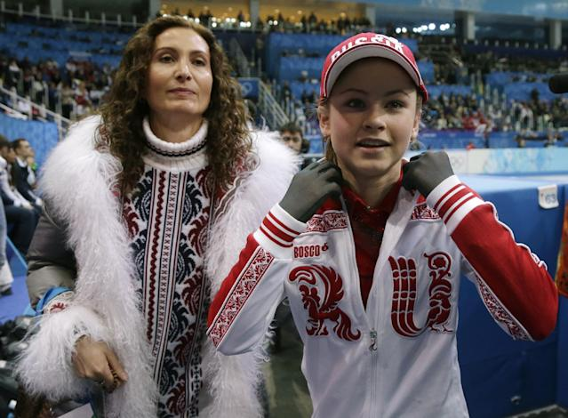 Julia Lipnitskaia of Russia, right, leaves the ice after competing in the women's team free skate figure skating competition at the Iceberg Skating Palace during the 2014 Winter Olympics, Sunday, Feb. 9, 2014, in Sochi, Russia. (AP Photo/Darron Cummings, Pool)