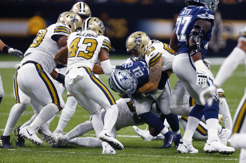 Dallas Cowboys running back Ezekiel Elliott (21) carries as New Orleans Saints outside linebacker A.J. Klein (53) tackles in the first half of an NFL football game in New Orleans, Sunday, Sept. 29, 2019. (AP Photo/Butch Dill)