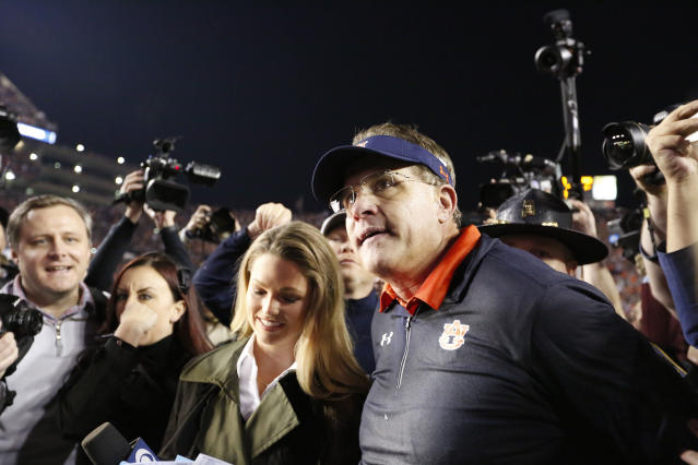 Auburn head coach Gus Malzahn on the field talks to the media after the Iron Bowl NCAA college football game, Saturday, Nov. 25, 2017, in Auburn, Ala. (AP Photo/Brynn Anderson)