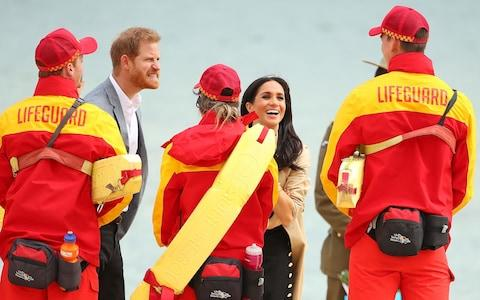 The Duke Duchess of Sussex meet lifeguards at South Melbourne Beach - Credit: Scott Barbour/Getty