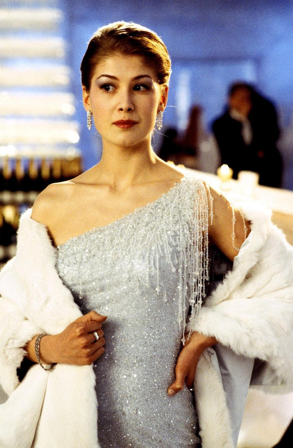 <p>Long before <i>Gone Girl</i>, Pike played an undercover MI6 agent. Her name is Frost — can't you tell by her icicle-themed gown and silver shimmery eyeshadow? But she's also double agent who betrays Bond. Don't worry — she gets hers. <i>(Photo: Everett Collection)</i></p>