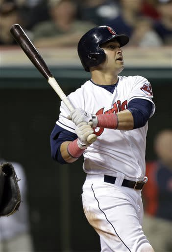 Cleveland Indians' Nick Swisher watches his solo home run off Oakland Athletics starting pitcher A.J. Griffin in the sixth inning of a baseball game Wednesday, May 8, 2013, in Cleveland. (AP Photo/Mark Duncan)
