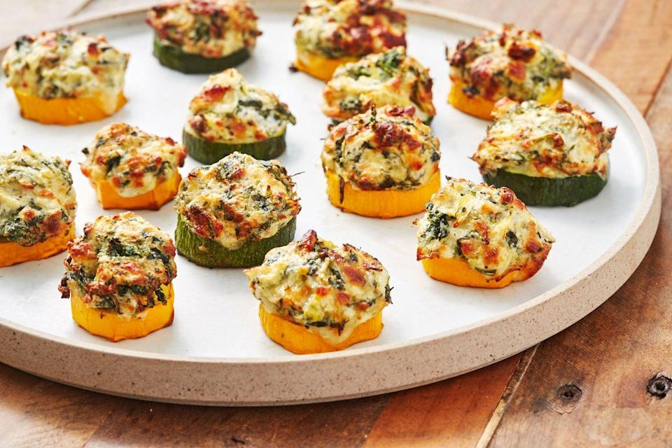 "<p>The perfect light bite that will satisfy you just until dinner. You would't want to spoil your appetite. </p><p><em>Get the recipe at <a href=""https://www.delish.com/cooking/recipe-ideas/a22876942/spinach-artichoke-zucchini-bites-recipe/"" rel=""nofollow noopener"" target=""_blank"" data-ylk=""slk:Delish"" class=""link rapid-noclick-resp"">Delish</a>.</em></p>"