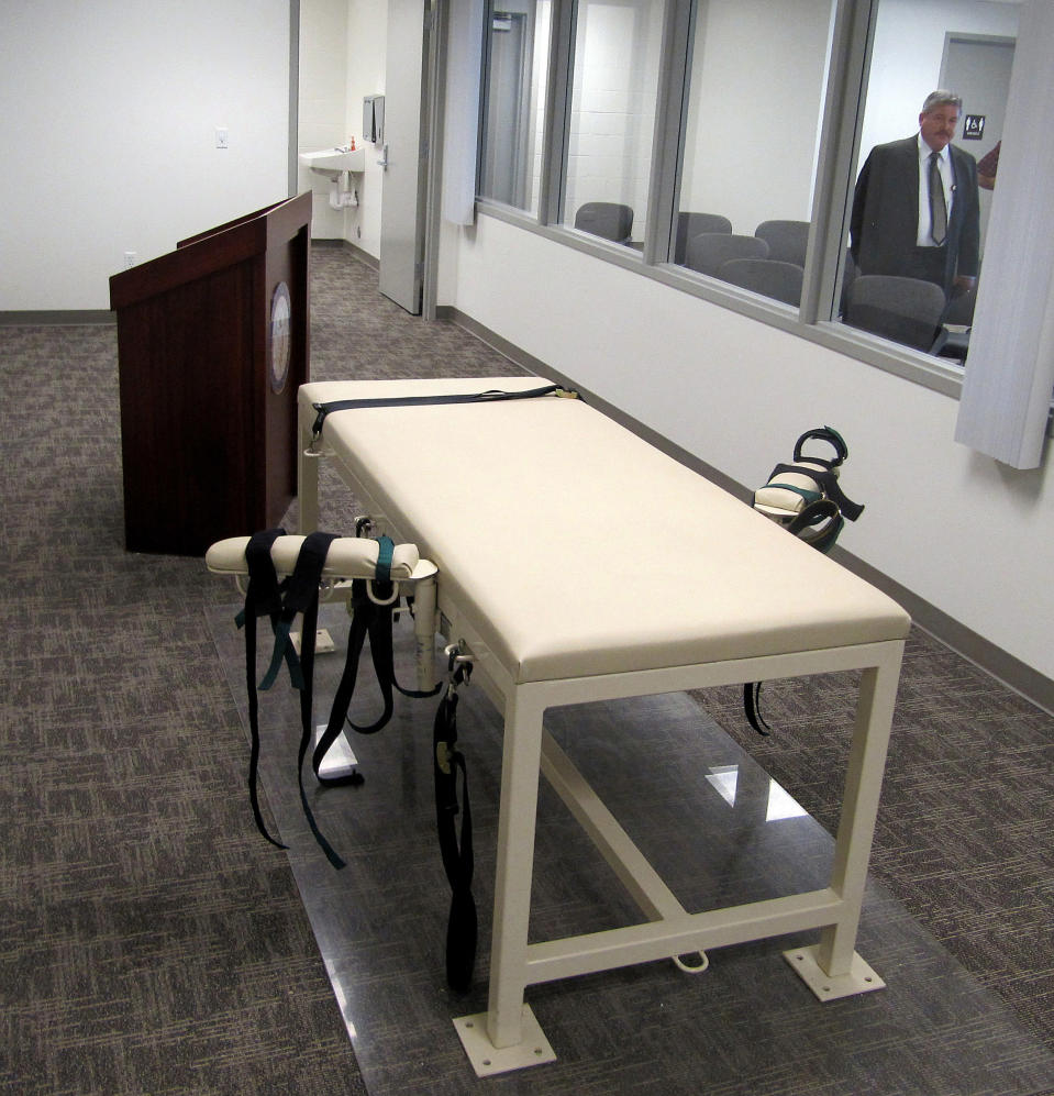 FILE - This Oct. 20, 2011 file photo shows the execution chamber at the Idaho Maximum Security Institution as Security Institution Warden Randy Blades look on in Boise, Idaho. The Idaho Supreme Court says state prison officials must turn over records that include information about where they obtained lethal injection drugs used in recent executions. The high court's ruling on Friday, Nov. 20, 2020, was a win for University of Idaho Professor Aliza Cover, who studies how the public interacts with the death penalty. (AP Photo/Jessie L. Bonner, File)
