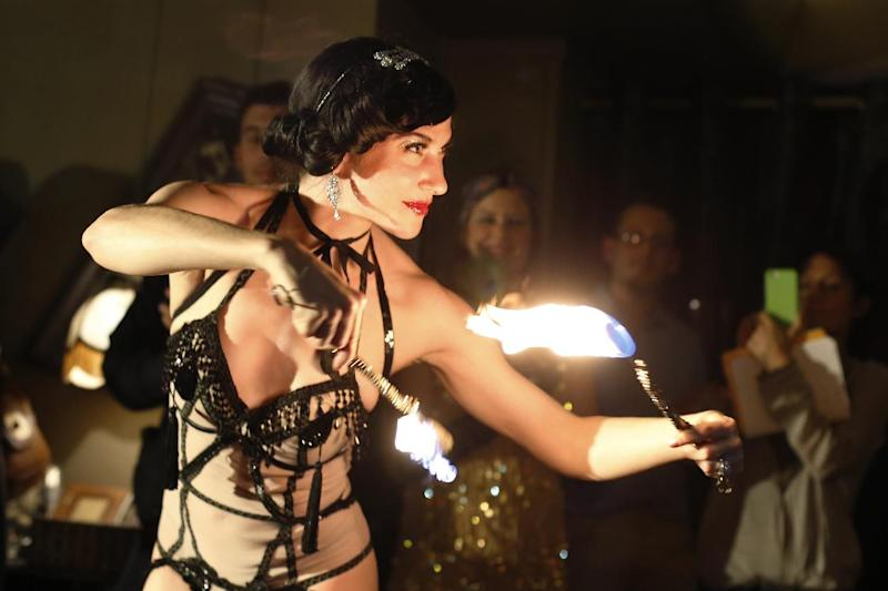 US-born burlesque dancer Louise de Ville performs at a bar in the Parisian district of Pigalle. France's libertine establishments range from seedy saunas to chic, exclusive clubs (AFP Photo/Thomas Samson)