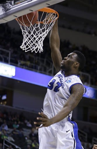 Saint Louis forward Cory Remekun (32) dunks against New Mexico State during the first half of a second-round game in the NCAA college basketball tournament in San Jose, Calif., Thursday, March 21, 2013. (AP Photo/Ben Margot)