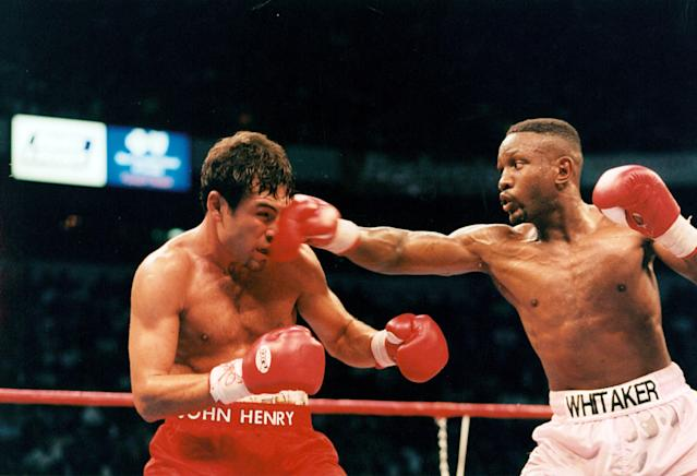 Oscar De La Hoya (L) is hit with a right punch from Pernell Whitaker during the fight at Thomas & Mack Center,on April 12,1997 in Las Vegas, Nevada.Oscar De La Hoya won the WBC welterweight title by a UD 12. (Photo by: The Ring Magazine via Getty Images)