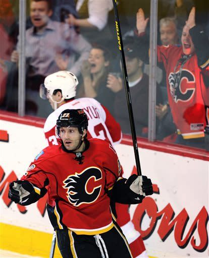 Calgary Flames' Lee Stempniak celebrates his goal against the Detroit Red Wings during the first period of their NHL hockey game in Calgary, Alberta, Wednesday, April 17, 2013. (AP Photo/The Canadian Press, Larry MacDougal)