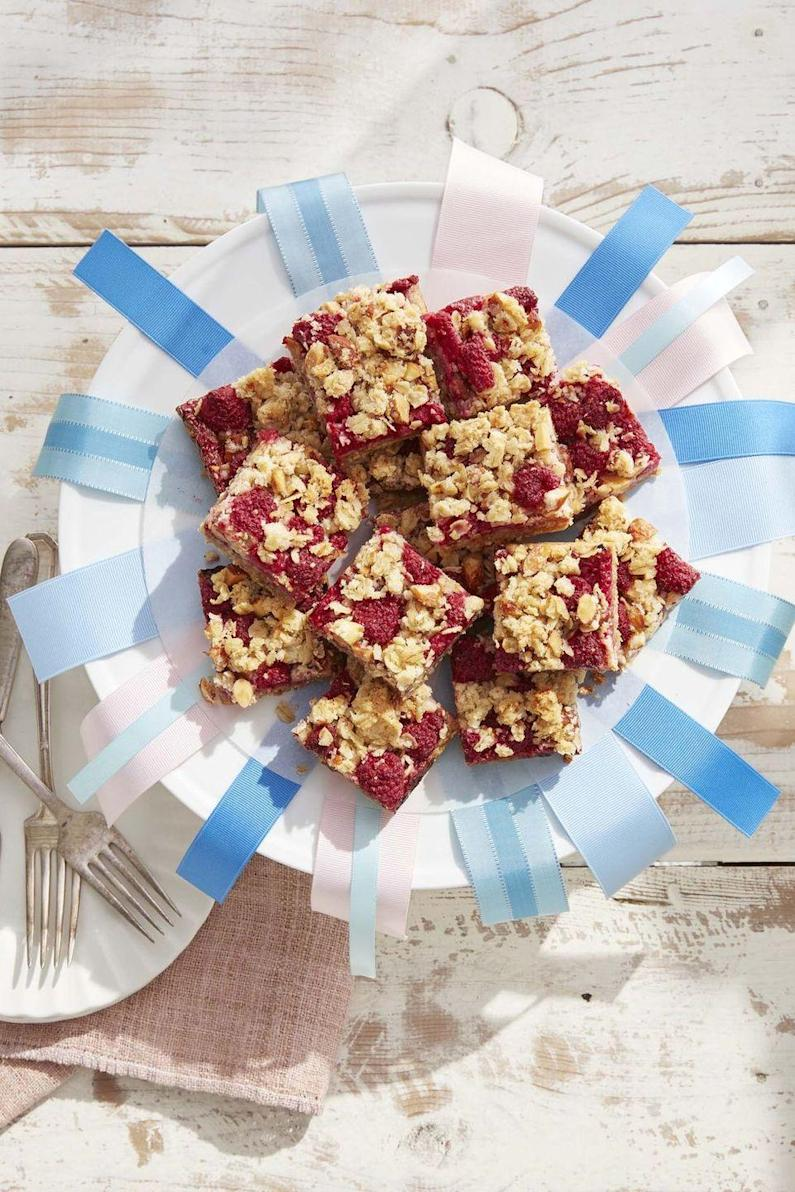 """<p>These easy oat bars are possibly the best use of fresh raspberries.</p><p><strong><a href=""""https://www.countryliving.com/food-drinks/a32042710/raspberry-crumb-bars/"""" rel=""""nofollow noopener"""" target=""""_blank"""" data-ylk=""""slk:Get the recipe"""" class=""""link rapid-noclick-resp"""">Get the recipe</a>.</strong></p>"""