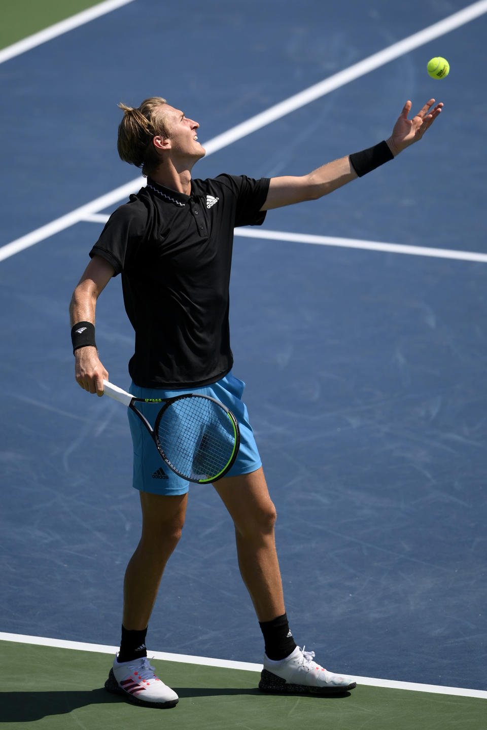 Sebastian Korda tosses the ball to serve against Jannik Sinner, of Italy, during a match at the Citi Open tennis tournament, Thursday, Aug. 5, 2021, in Washington. (AP Photo/Nick Wass)